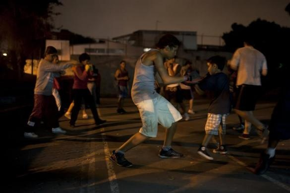 Youths practice Olympics-style street boxing during a training session in the low-income neighborhood of Propatria in Caracas February 8, 2011.  REUTERS/Carlos Garcia Rawlins