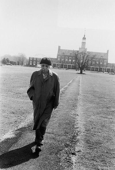 Einstein walks through the campus of Princeton University. #alberteinstein