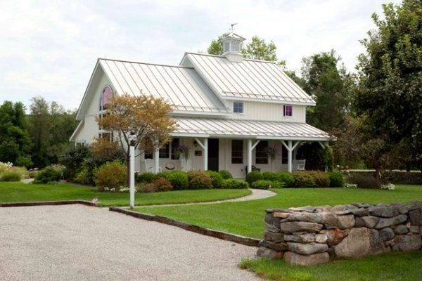 farmhouse with standing seam metal roof