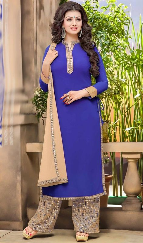 Look graceful just like Ayesha Takia dressed in this blue color georgette palazzo suit. This attire is nicely made with lace and mirror work. #ayeshatakia #bollywood #palazzosuit