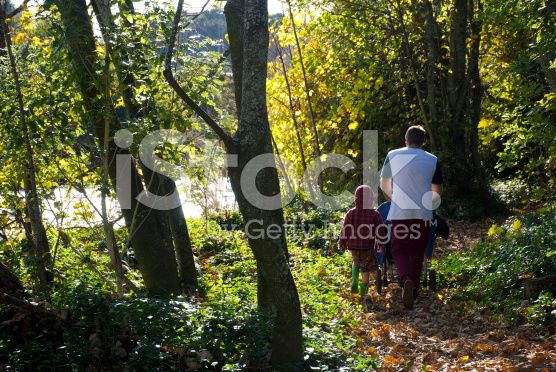 Father and Child Walking through Woods in Fall royalty-free stock photo