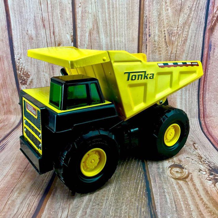 Vintage Tonka Dump Truck 4000 circa 2009 Hasbro back lift up pressed steel body