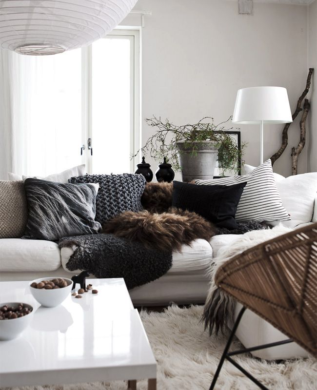 This may be the softest most enveloping living room I could imagine; furs, minimal decor yet what's there is cozy and fitting / Daniella Witte