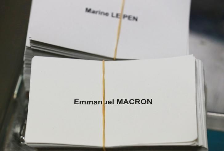 Ballots with the names of 2017 French presidential election candidates Emmanuel Macron (Bottom) and Marine Le Pen are seen near ballot boxes on the eve of the second round of the French presidential election, at a polling station in Tulle, France, May 6, 2017. REUTERS/Regis Duvignau    -- Well, Republicans, you'll burn in Hell for helping this happen. Stay warm!