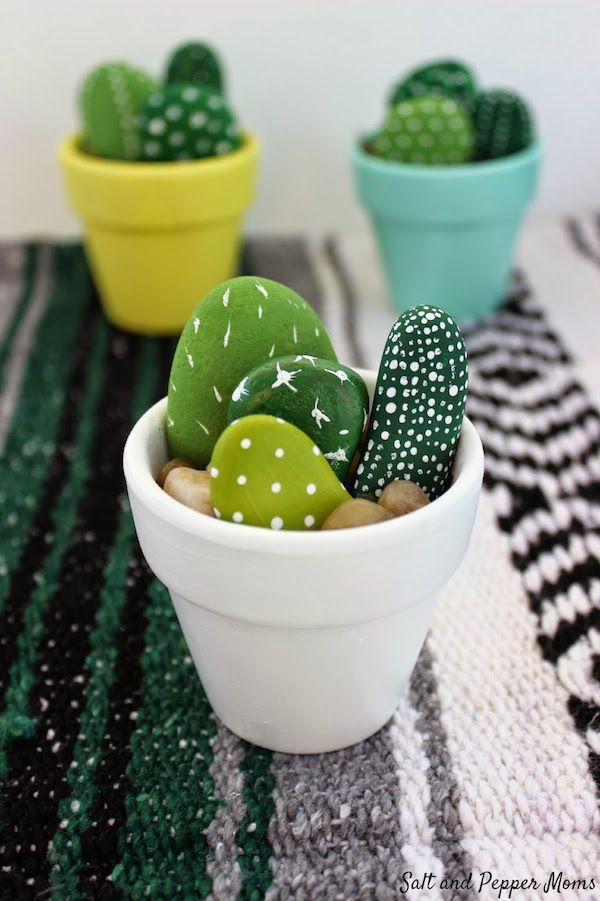 Painted rock cactus craft idea. Great DIY for kids but we think they make neat place settings too.   Salt and Pepper Moms