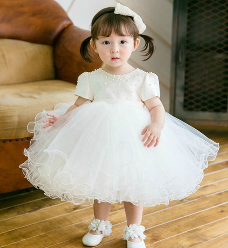 White Pearl Dress-Made To Order High Quality White Cap Sleeve Pearl Appliques Baby Girl Dress Perfect for communion, baptism, wedding, birthday or any special occasion Available from 3 month until 12 years old  Material: Satin, soft polyester fiber, purified cotton lining, tulle mesh, lace, pearl Before checkout, you may leave a note your little girl's height, bust and waist measurements so we can process it and send you the right size. Thank you for choosing Girly - A Taste For A Girl!
