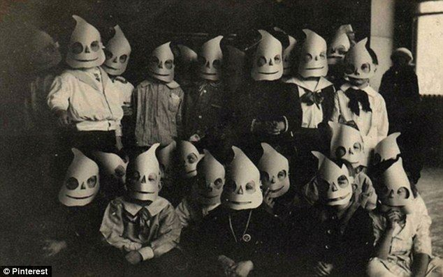 Eerie: A group of masked children go for the spooky look on Halloween
