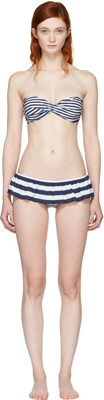 Technical jersey bikini striped in navy and white. Bandeau top featuring braided band at front. Underwire at cups. Logo engraved tab-slot fastening at back. Hipster-style bikini bottoms featuring ruffled trim at waistband. Fully lined. Gold-tone hardware. Tonal stitching.