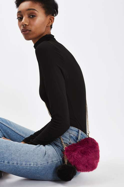 Store your essentials the luxe way in this faux fur heart bag with a contrast pom attached and zip around fastening detail. Zip around fastening. #Topshop