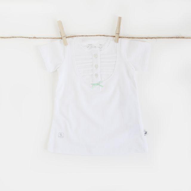 Ducky Beau tuniek wit   Meisjes tuniek jurkje met mintgroen strikje en witte knoopjes. Langs hals en mouwen afgewerkt met wit kant. In de kleur wit.
