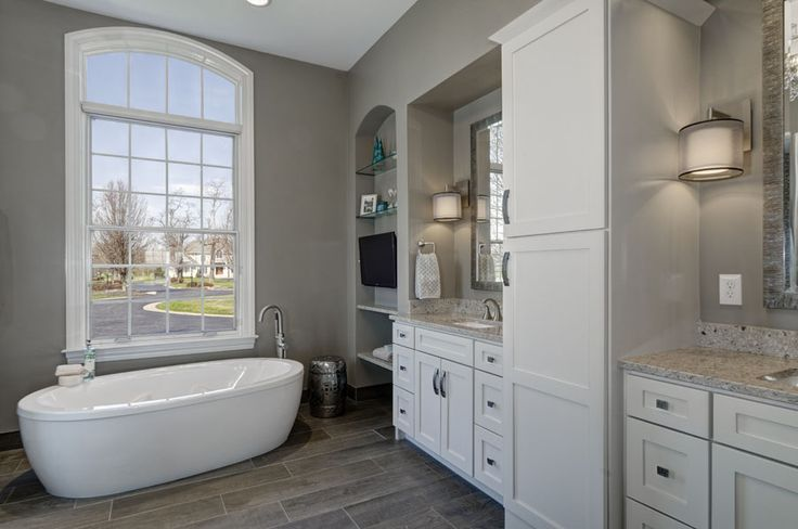 Bathroom remodel by Dave Fox Design Build Remodelers with freestanding tub and custom built in cabinetry. #davefox #housetrends