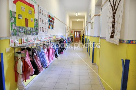 Inside of a kindergarten with aprons hanging