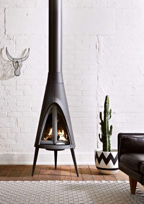 Cool fireplace, nice wire bull head, good looking cactus.