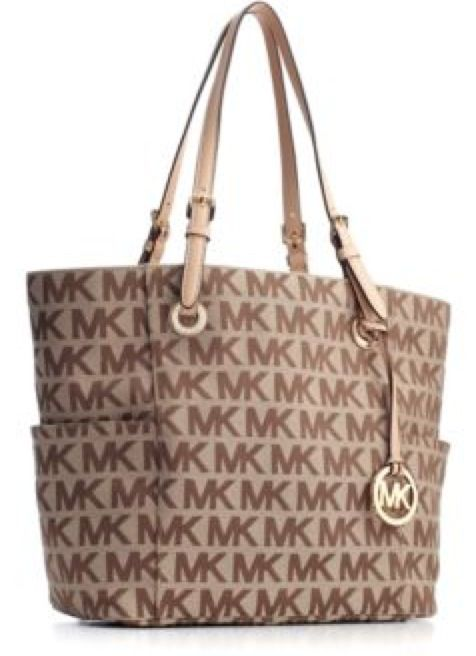 Micheal Kors . I bought this bag today :) half off plus my employee discount only make it 68$!!! But mine is gold and Joseph got me the matching wallet ♥♥ I'm spoiled you guys lol