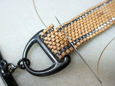 How to Fold Peyote Stitch Over a Clasp, from http://www.artbeads.com/how-to-finish-peyote-bracelet.html?fromMobileSite=true