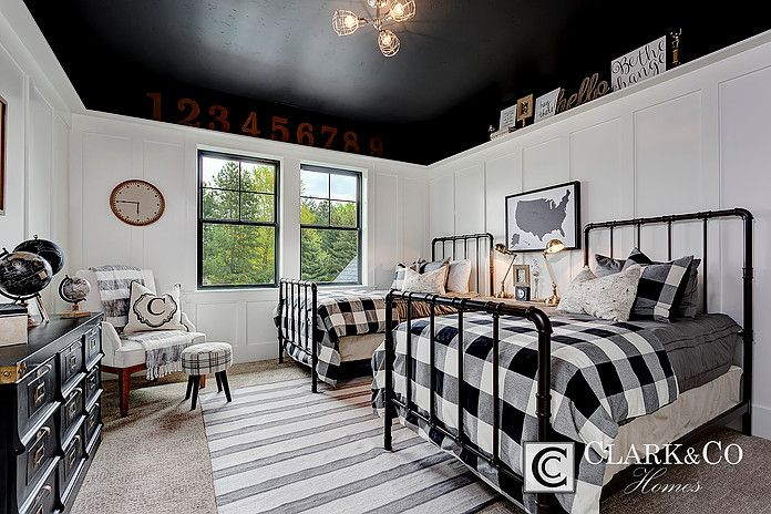 "Clark & Co Homes - 2016 Spring Parade Home ""The Heartland"". Modern Farmhouse. www.clarkandcohomes.com. Built-in cabinetry; White Dove by Benjamin Moore; Black Magic. Boys bedroom. Black ceiling. Wainscot board and batten white. Industrial twin bed frames."