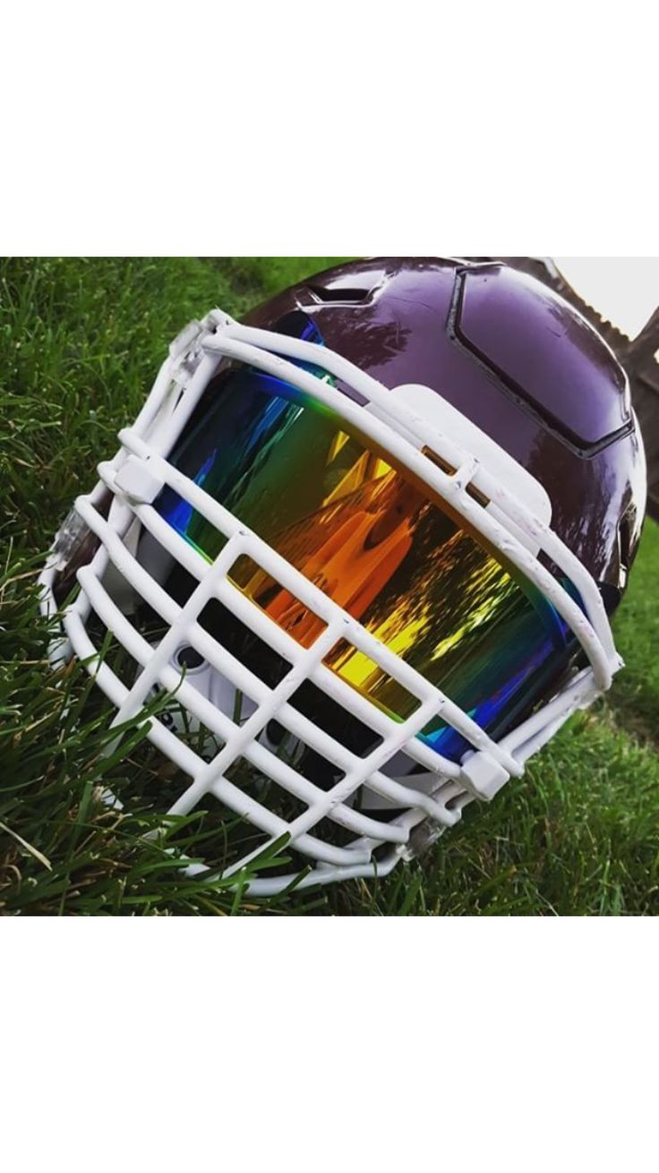 Purple Riddell SpeedFlex helmet with white Big Grill facemask and an orange iridium SHOC visor