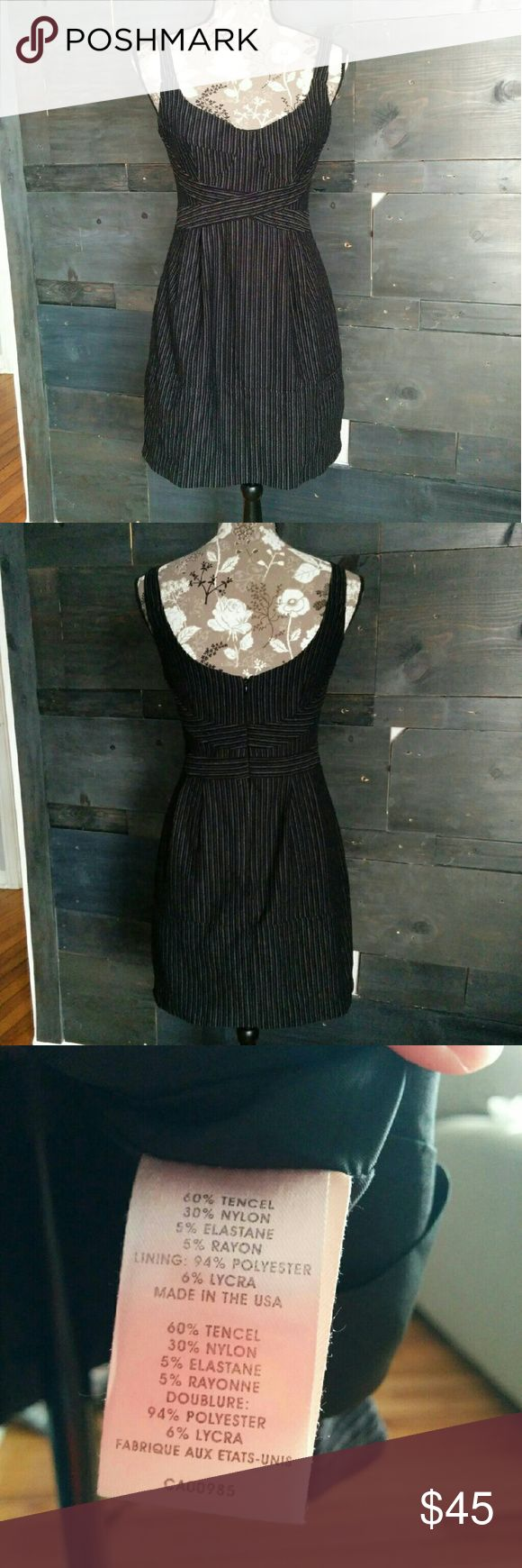 Nanette Lepore striped dress Beautiful sleeveless gray mini dress with vertical stripes. Fully lined with a zipper in the back. Made in the USA. Nanette Lepore Dresses Mini