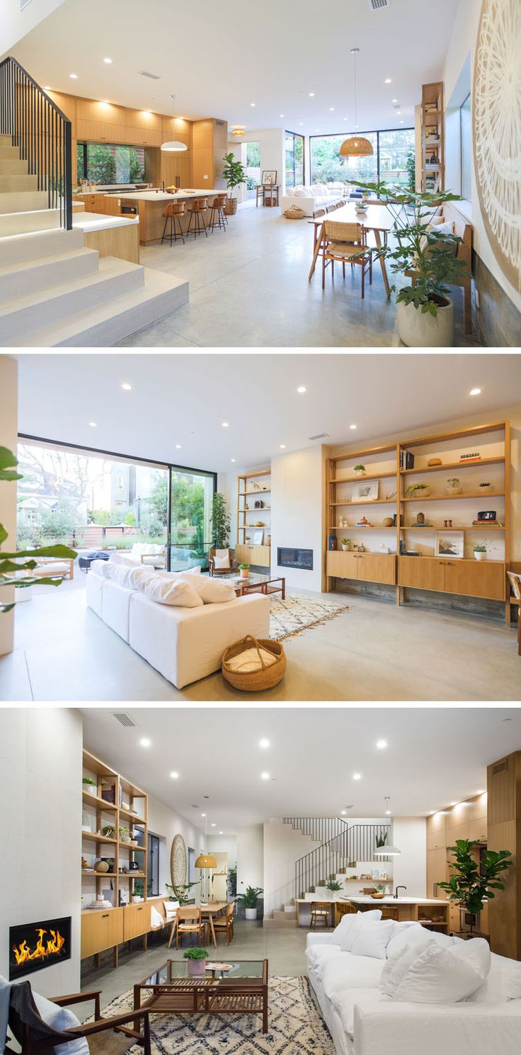 The living room in this modern open floor plan features warm custom millwork in the form of shelving units that sit on each side of the fireplace, and it also opens up directly to the outdoor living room