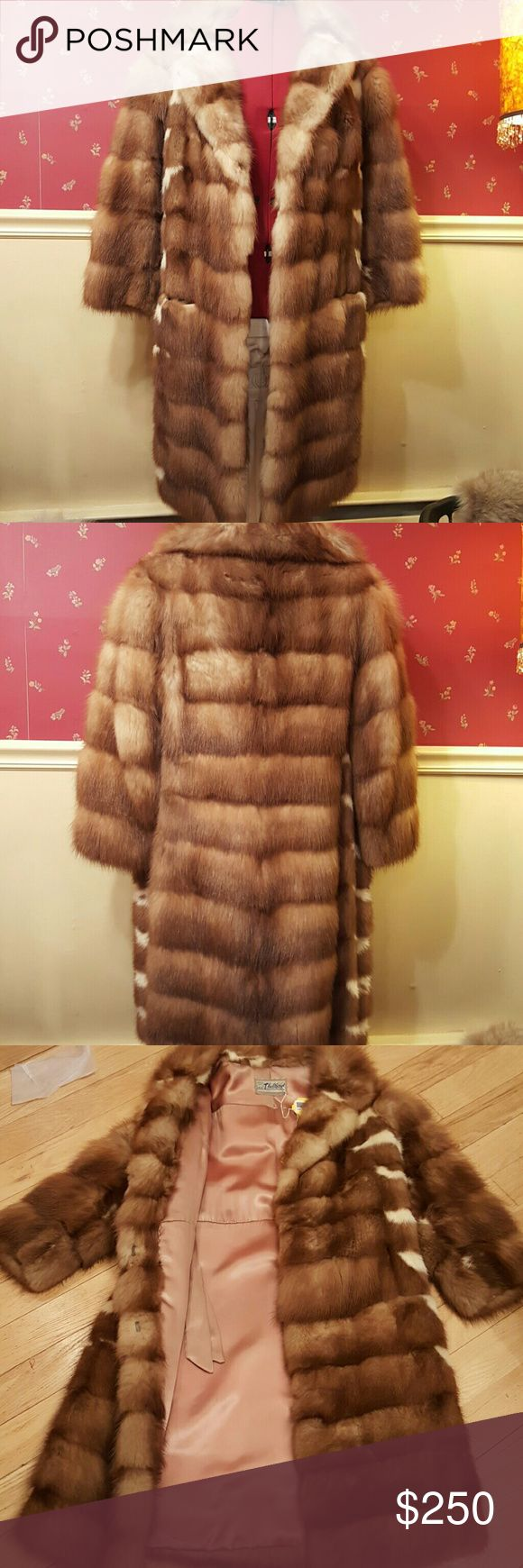 """Stone Martin Mink Totally cool, Aspen Villge vibe to this vintage Stone Marten mink coat. Wear with cowboy boots, jeans and a turtle neck! Size small, 20"""" across back at chest. Probably fit XS as well. Sleeve 20"""" from shoulder seam. Seems to me to be a bit of a petite size. Three working hooks in front. Two slash pockets in front. Stone Marten has cool cream colored sections to the mink. Jackets & Coats"""
