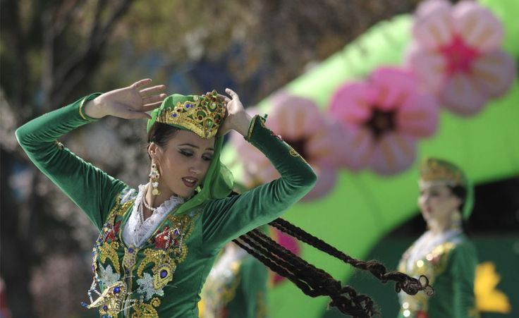 Folk dancers in national costumes perform during the festivities marking the holiday of Navruz in Tashkent, Uzbekistan. Description from pinterest.com. I searched for this on bing.com/images
