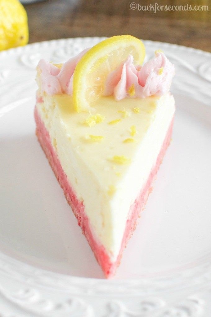 Lemon Cheesecake with Strawberry Crust ~ The combination of strawberry and lemon is so bright and vibrant, it just makes me happy. This lemon cheesecake is light and creamy and it sits on a chewy strawberry cookie crust. It's easier than you think to make, and everyone will be impressed!