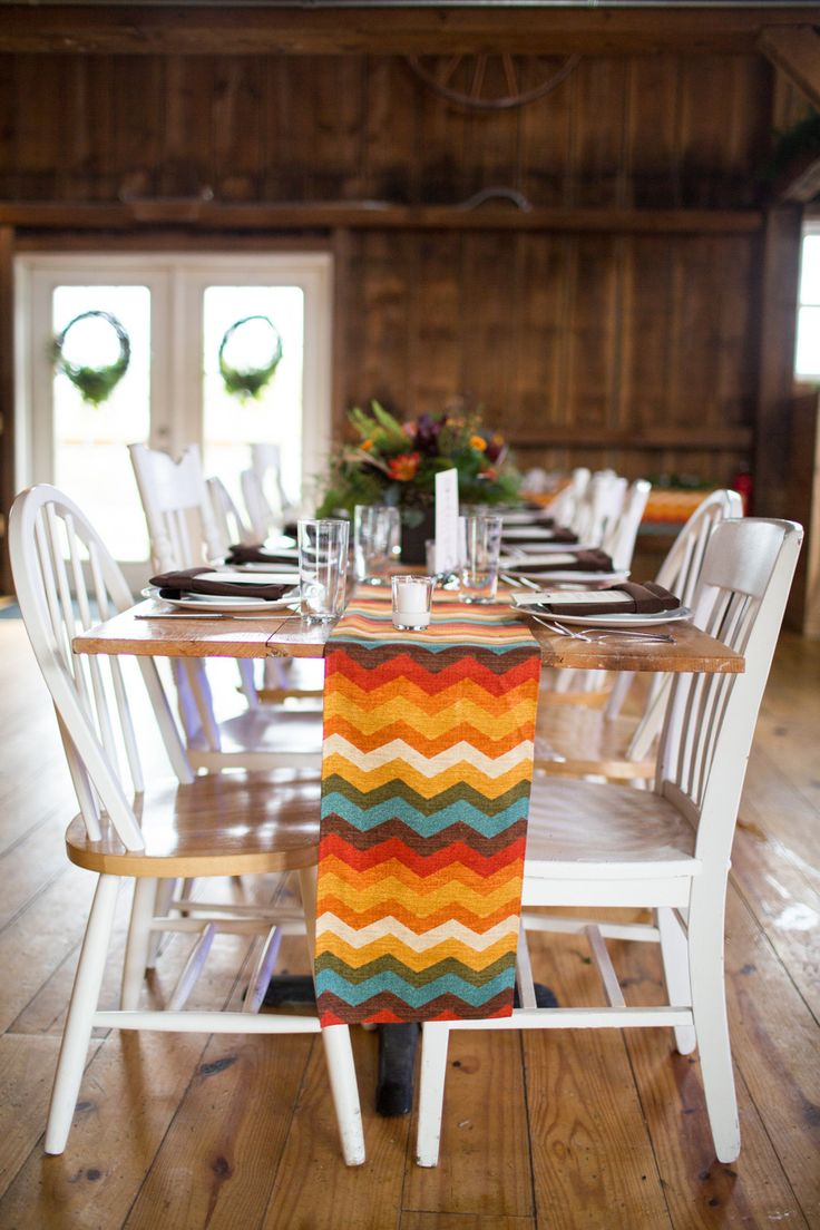 Patterned Fabric for Table Runners Set the Tone of This Festive Wedding! See the wedding on SMP: http://www.StyleMePretty.com/2014/02/27/the-barn-at-harvest-moon-pond-wedding/ Dani Stephenson Photography
