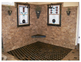 Roll-in shower tile work gives visual cue.