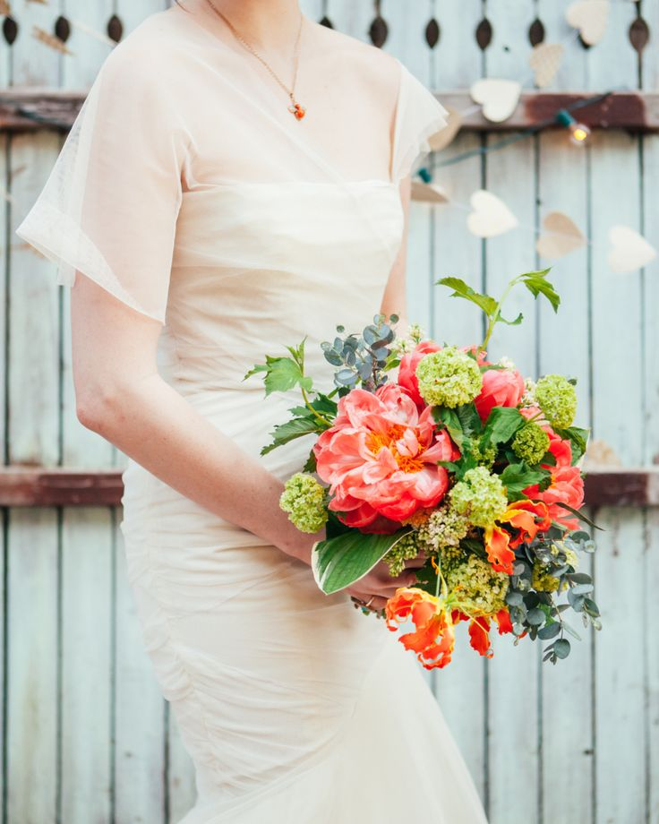 {{Bride holding bright garden-style bouquet with pink peonies, gloriosa lilies, and green snowball viburnum for spring wedding editorial at Lovely Kitchen and Cafe in Chicago, featured in Style Me Pretty.}} Photography by Studio Finch http://studiofinch.com/    Flowers by Pollen, pollenfloraldesign.com