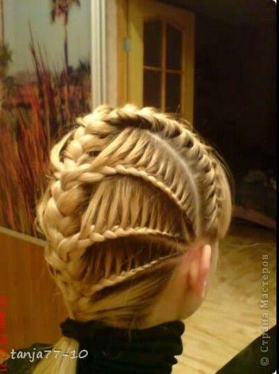 layered lace braids into main 3 strand braid. Unique!