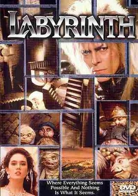 Labyrinth. I totally would have given into Jareth. Mmmm...David Bowie, 80's hair, eye make up on, sock in his pants. YAY!