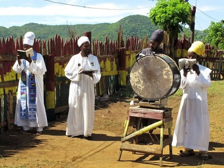 In this November 19, 2012 photo, a group of robed Rastafarian priests chant prayers while facing the direction of the African nation of Ethiopia at the Bobo Ashanti commune in Bull Bay, Jamaica. More people are joining Jamaica's home-grown Rastafarian religion some 80 years after it was founded by the descendants of African slaves in response to black oppression on the Caribbean island.  Via the Jamaican Gleaner.