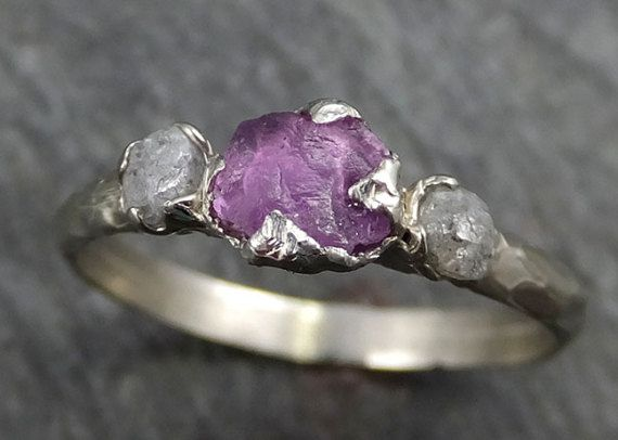 Raw Sapphire Diamond White Gold Engagement Ring Purple Wedding Ring Custom One Of a Kind Gemstone Ring Three stone Ring byAngeline 0441 Raw rough sapphire surrounded by two raw conflict free diamonds. I hand carved this ring in wax and cast it in solid 14k white gold using the lost wax casting process. This one of a kind raw gemstone ring is a size 6 1/2 it can be sized. The sapphire stone measures about 5mm X 4mm. The rough diamonds are about 3mm. Through out all of time and history i...