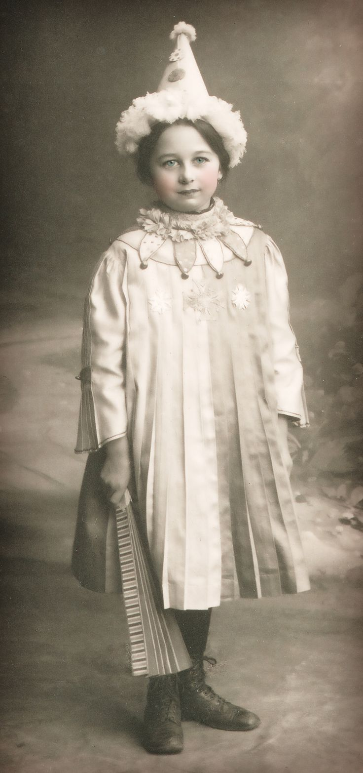 Vintage Halloween photo, little girl in clown costume