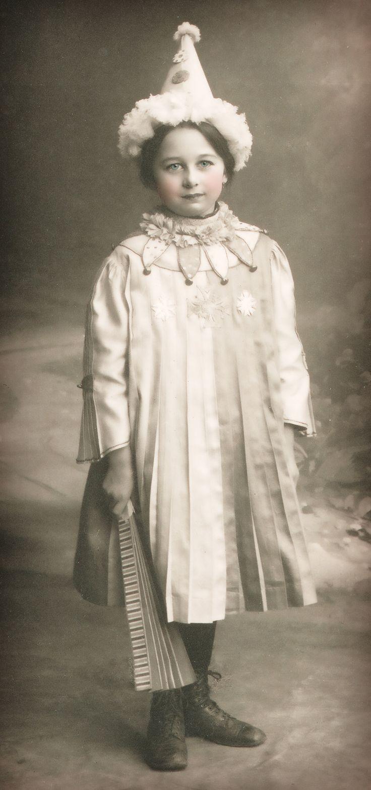 Vintage Halloween photo, little girl in clown costume