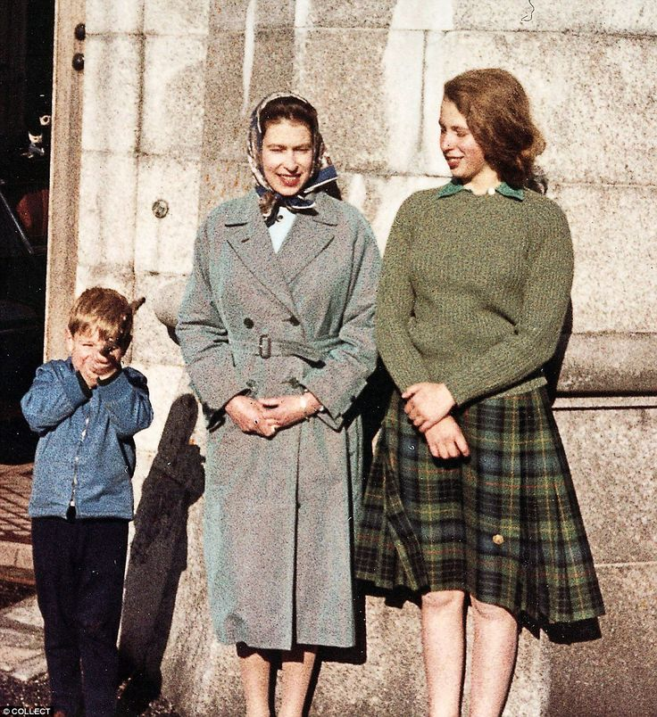 Prince Andrew strikes a playful pose with his mother and his sister Princess Anne.