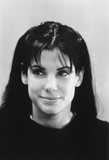 Sandra Bullock in While You Were Sleeping...i love her clothes in this movie. Big sweaters and sweats. I bet she was comfortable.