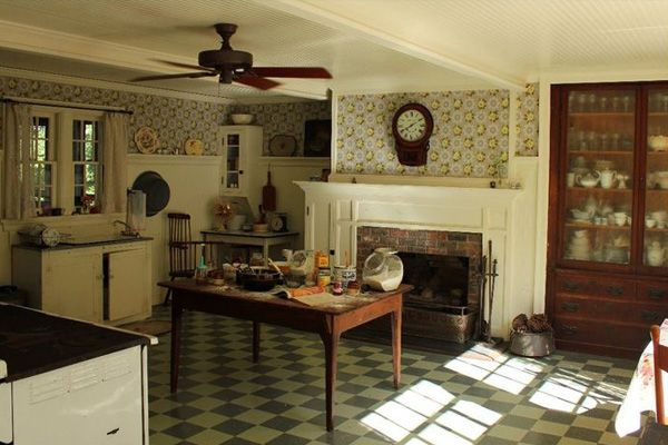 Celia's kitchen from The Help. LOVE the floral wallpaper, checkered floors, and overall 1930s farmhouse feel.
