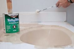 use Rustoluem tub and tile paint to refinish an integral sink and countertop bathroom vanity @Remodelaholic