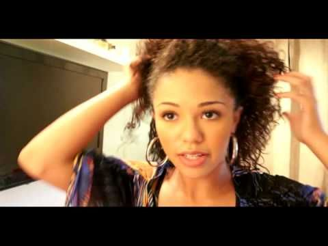 Here's an interesting twist on a ponytail for biracial/curly hair.