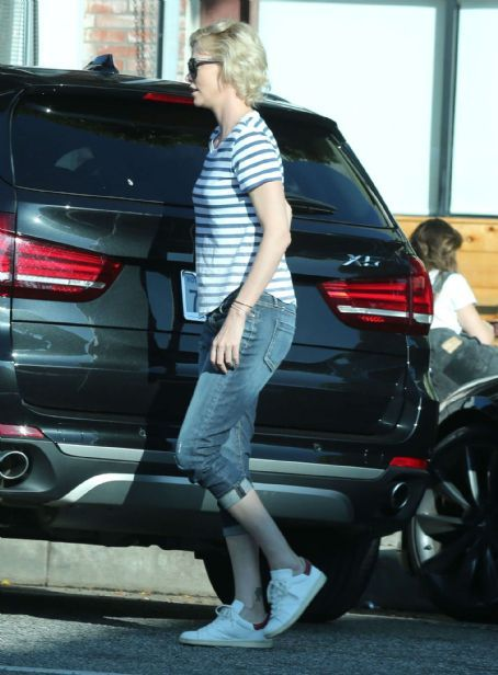 Charlize Theron In Jeans Out In Hollywood