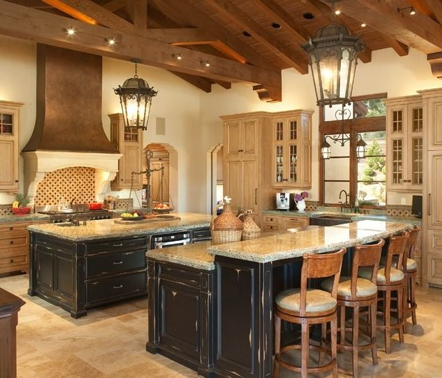 Double Island design, huge lanterns, wood ceiling and beams, recessed lighting in ceiling
