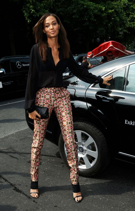 Joan Smalls.When paired with a sheer blouse, Joan Smalls' festive party pants are a great alternative to a cocktail dress. Add your highest heels and you're ready to party.