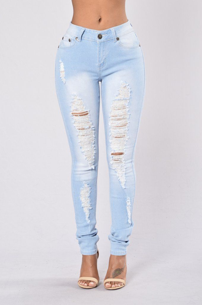 - Available in Light Blue - Mid Rise Jeans - Skinny Leg - Stretch Material…