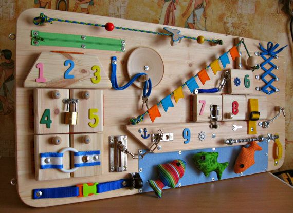 A busy board for children 2 - 4 years. Size: 40 x 80 cm (16 x 32 inches). Weight about 4,6 kg. All items are securely fastened . For your childs safety must be adult supervision. Here you will find the elements that attract the attention of the child: 1) Ship with different clasps, 2 ) a house with different fasteners and pictures cut out from fabric, , 3) Sea with 3 fish of fabric based on Velcro, 4) wheel, rotating with knob in both directions and other interesting things. A design idea…