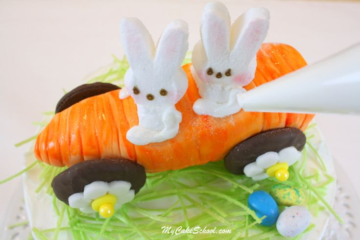 The CUTEST Carrot Car with Peeps Bunnies! Free step by step Cake Topper Tutorial by MyCakeSchool.com! So adorable for Easter cakes!