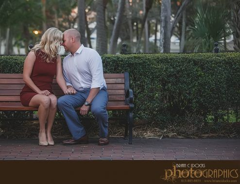A sweet moment from Capri and Logan's University of Tampa engagement session as they snuggle on a park bench.  Professional wedding photography by Brian C Idocks Photographics. www.briancidocks.com