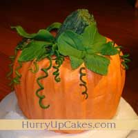 I made this cake for my honey's bday of Halloween. Mine came really close to the picture. Lots of Buttercream frosting and fondant. http://www.hurryupcakes.com/shaped-cakes/food-shaped-cakes/pumpkin-shaped-cake#