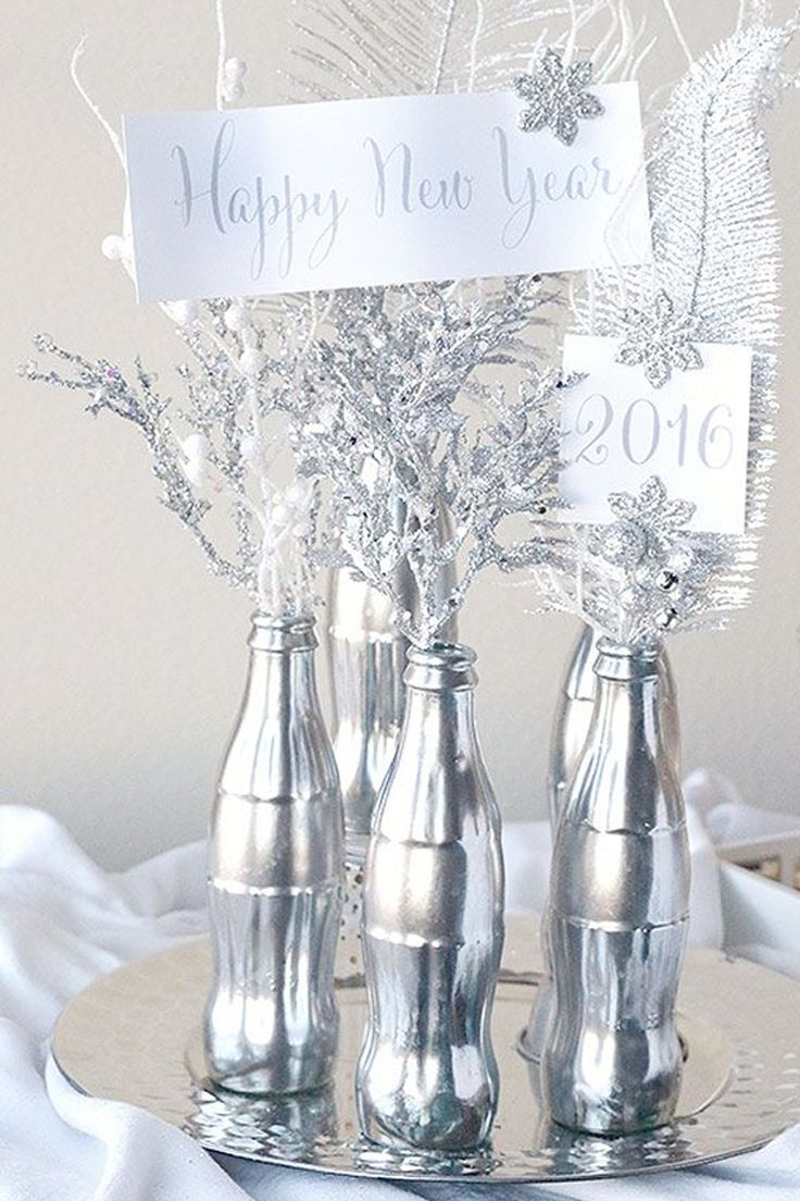 Recycle your old @Coca-Cola bottles and create this Mercury Centerpiece #NYE #newyearsevedecoration #silver #partyideas