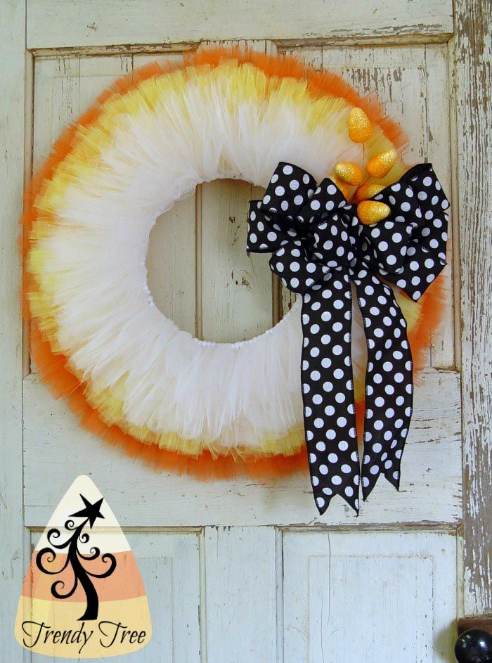 Trendy Tree tutorial for making a Candy Corn Wreath for Halloween using a wreath frame, Tulle, ribbon and Candy Corn picks.